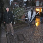 Astride the Prime Meridian, in the rain. The real tourists were queued up to pose before a plaque, for some reason.