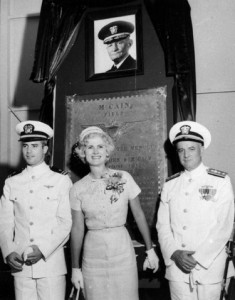 A young John McCain with his parents, under a monument to his grandfather.