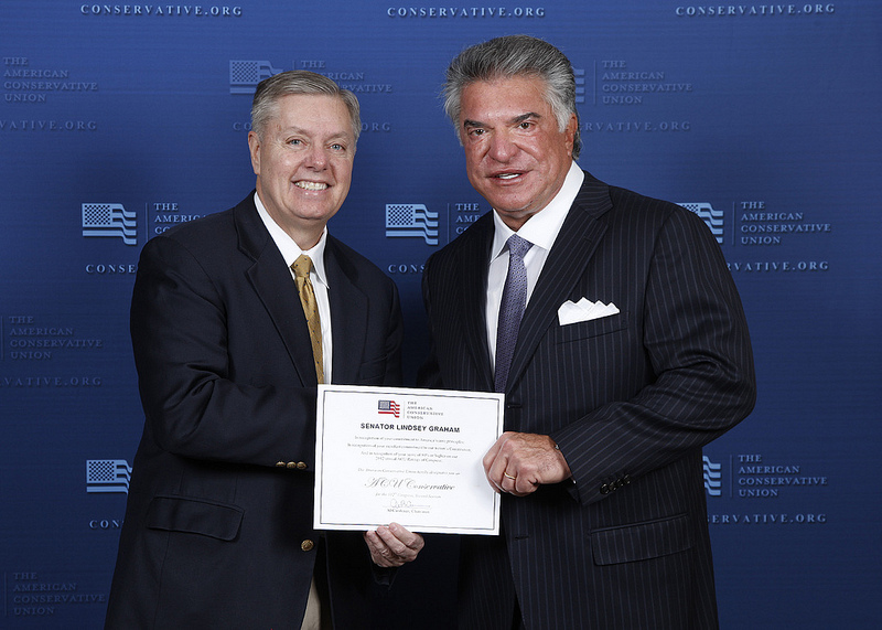 Lindsey Graham receives an award from Paulie Walnuts of &quot;The Sopranos.&quot; No, wait -- that's probably someone from the ACU. The release didn't identify him...