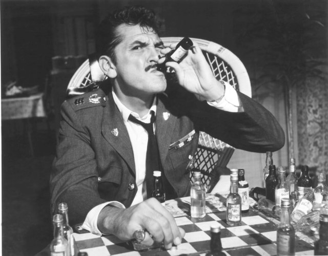 "Ernie Kovacs playing minibottle chess in ""Our Man in Havana."""