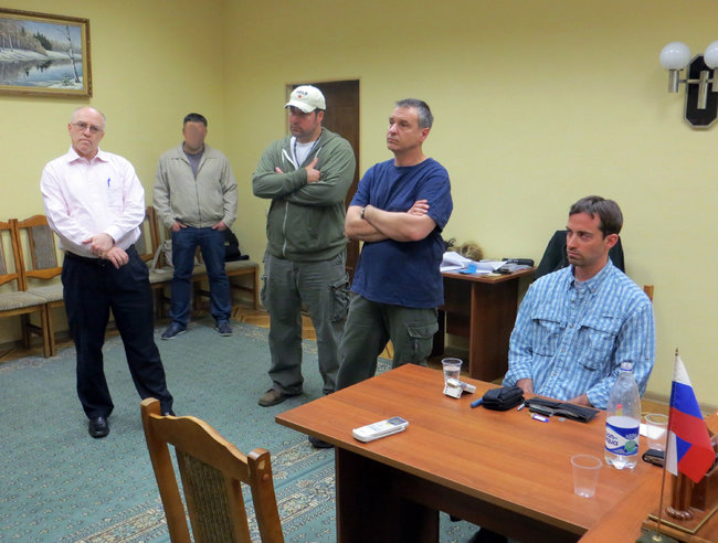 FSB photo showing alleged International Man of Mystery Ryan Christopher Fogle, seated at right.