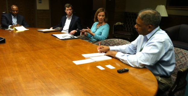 Warren Bolton, Herbert Ames, Irene Dumas Tyson and Roddie Burriss in the editorial boardroom earlier this week.