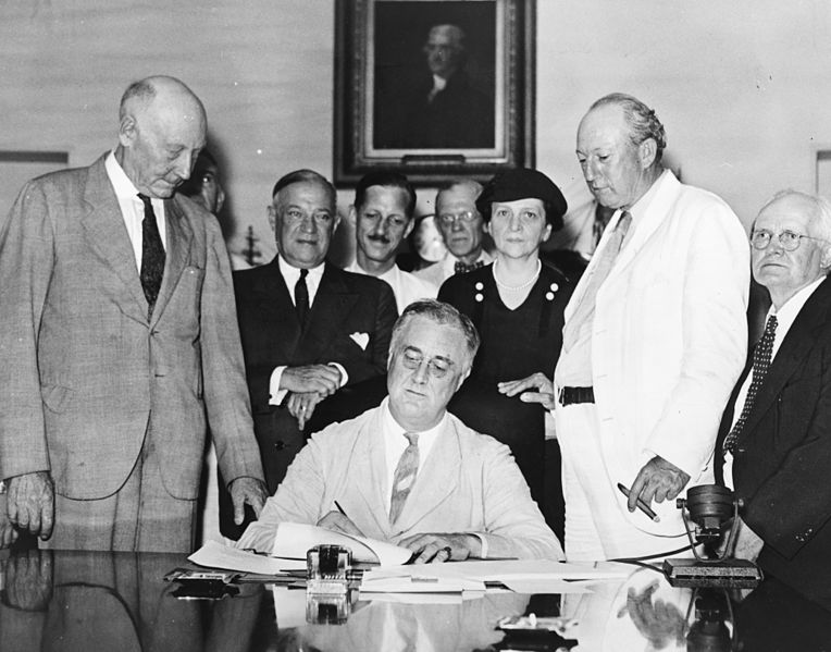 FDR signs the Social Security Act in 1935.
