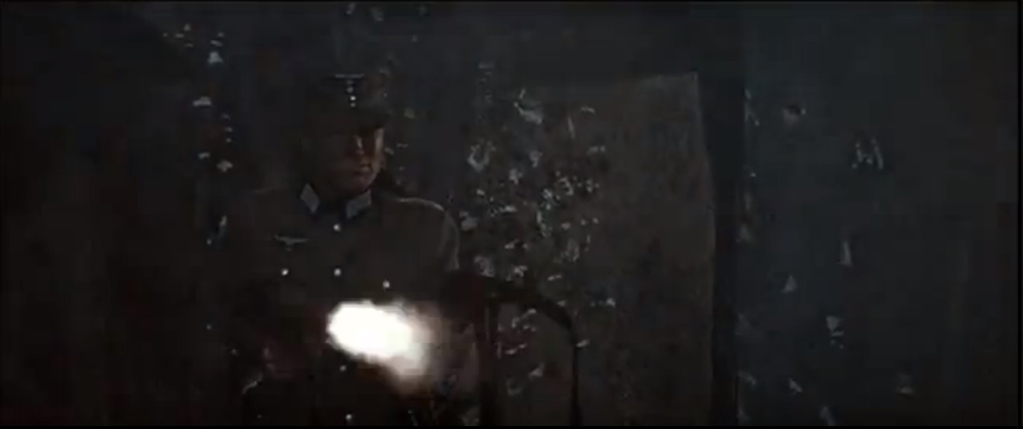 "Clint Eastwood firing two MP40s at the same time in ""Where Eagles Dare."""