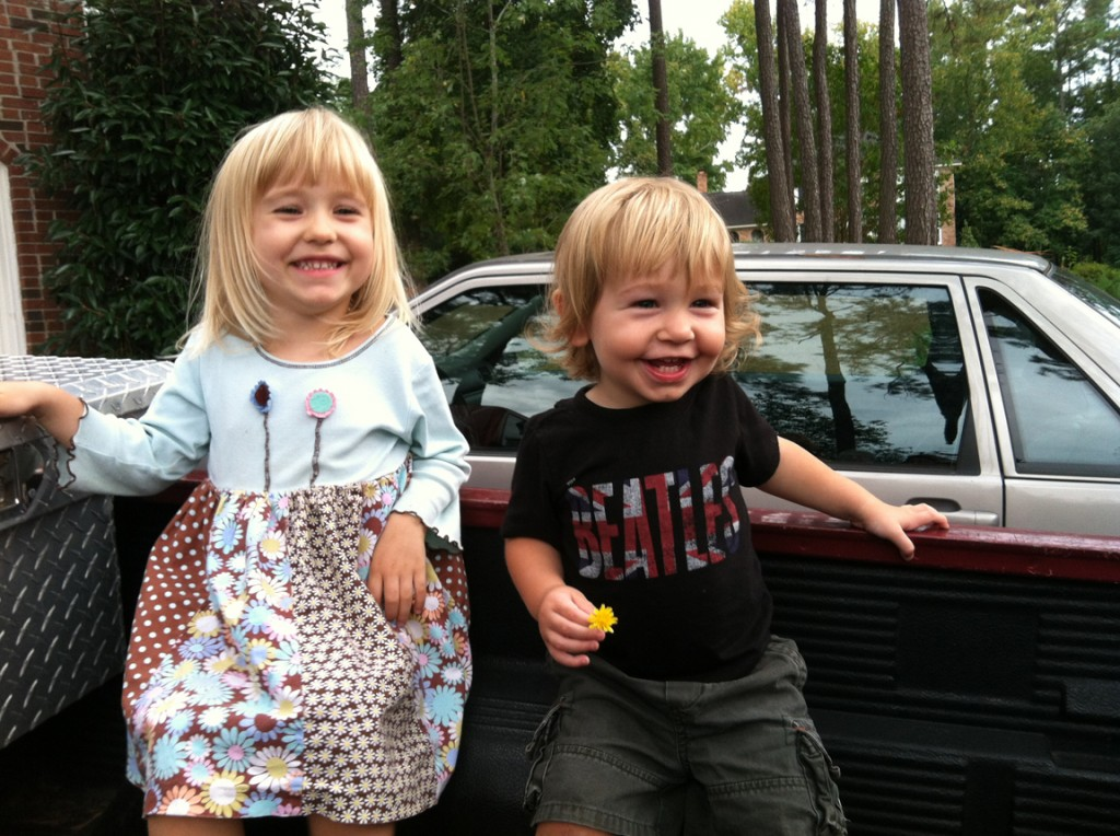 The Before look: Having a laugh with his big sister in the back of my truck a couple of weeks ago.