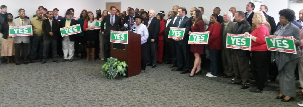 A group of neighborhood and community leaders gather to endorse strong-mayor on Monday.