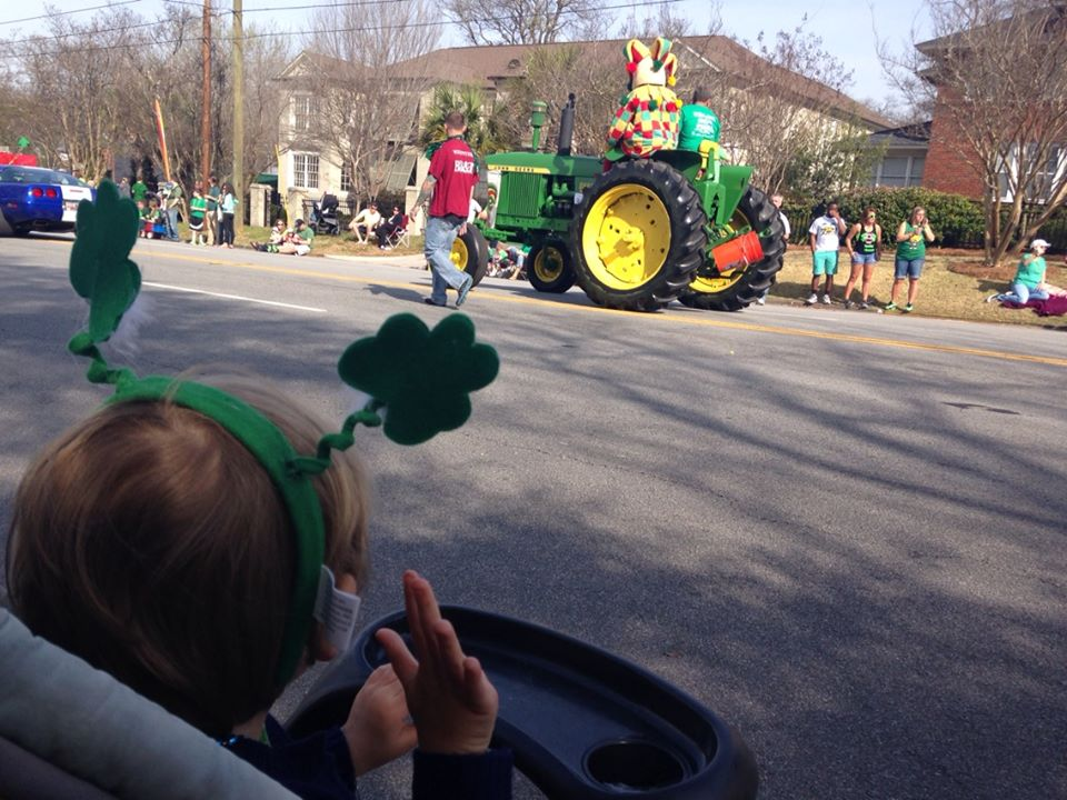 My grandson, waving to a tractor in the parade. You have to understand, that tractor was The Most Important Thing in the parade...