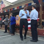 Bakari Sellers and Vincent Sheheen applauding as candidates were introduced.