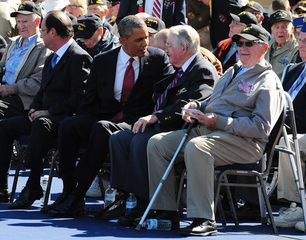 President Barack Obama chats with John Cummer of Blythewood, a World War II veteran in Normandy, France, for the 70th anniversary of D-Day. Winston Pownall of West Columbia, another veteran on the trip, is next to Cummer. SGT. MICHAEL REIHSCH — U.S. Army Europe