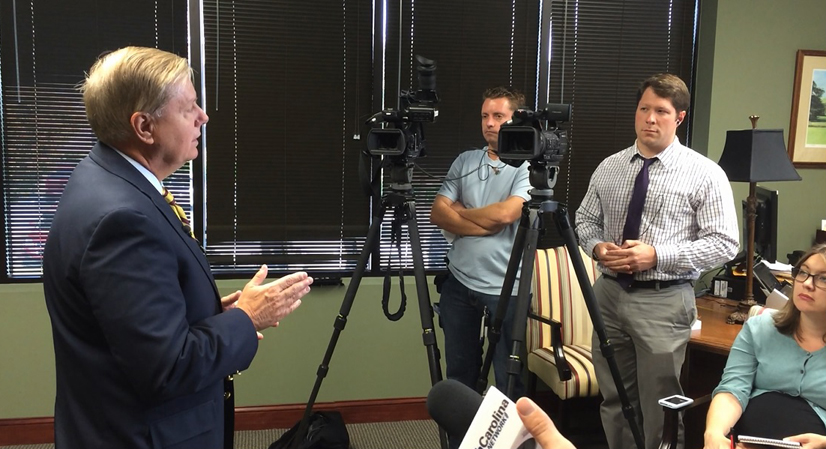 Sen. Lindsey Graham speaks to reporters in his Columbia office.