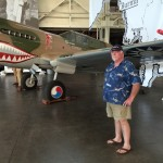 Burl in front of one of the museum's trademark exhibits -- a P-40 painted as a Flying Tiger.