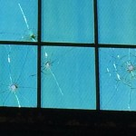 Machine-gun holes in the windows of the big hangar, left from the attack on Dec. 7, 1941.