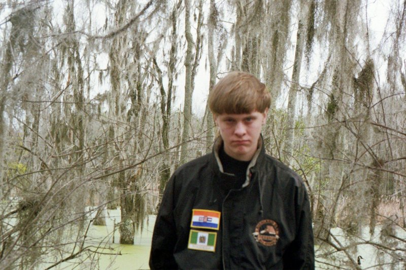 Dylann Storm Roof, wearing Rhodesian and South African flags, from his Facebook page