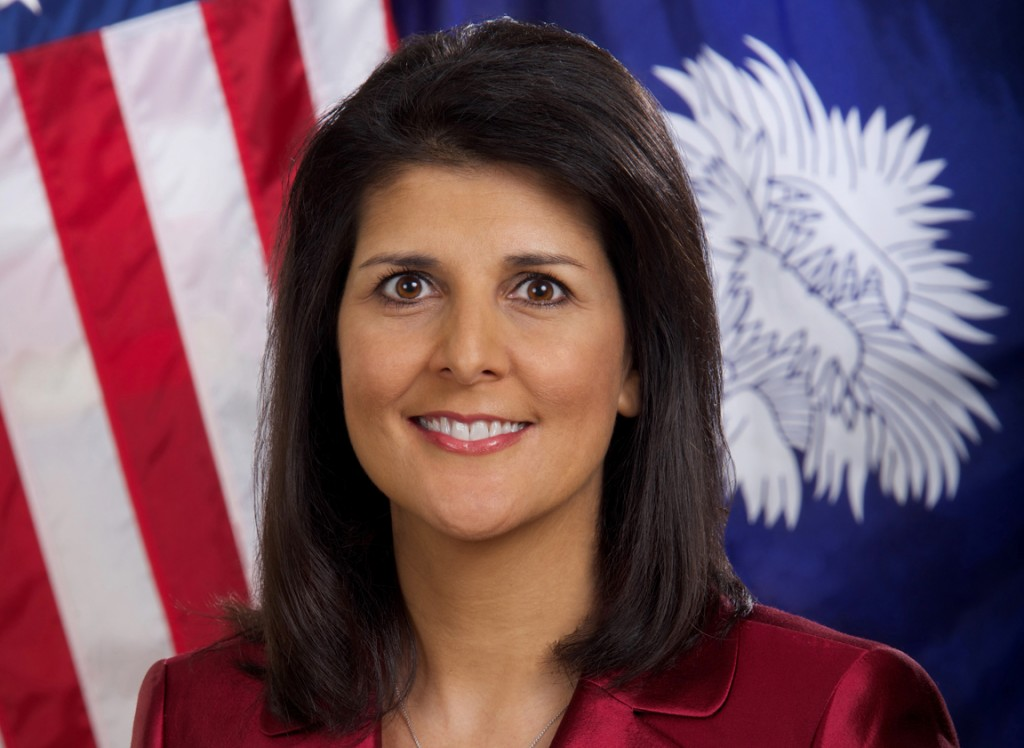 Gov. Nikki Haley's official photo, in which she poses with the only two flags South Carolina needs.