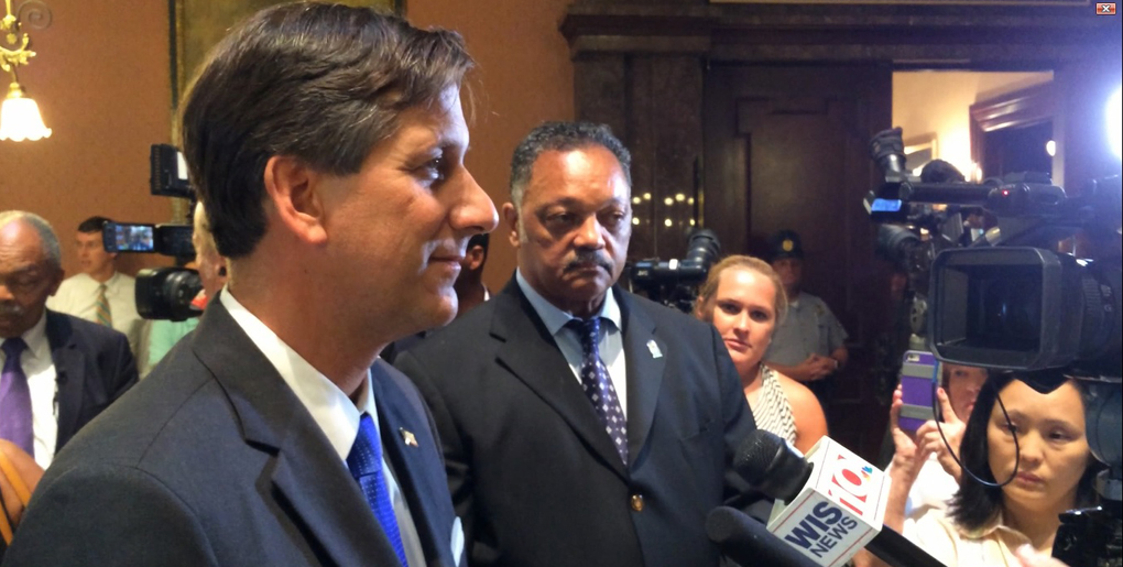 Bill sponsor Vincent Sheheen fields media questions after the vote while the Rev. Jesse Jackson looks on. Jackson is much more pleased than he looks; I had just spoken with him.