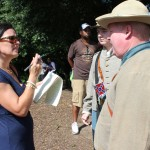 Valerie Bauerlein of The Wall Street Journal interviews a couple of Confederate re-enactors from Fort Mill.
