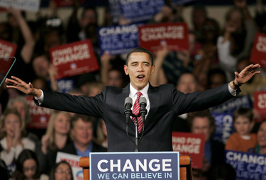 Democratic presidential hopeful, Sen. Barack Obama, D-Ill., responds to a warm welcome from the audience as he approaches the microphone during a South Carolina victory party in Columbia, S.C. Saturday, Jan. 26, 2008. (AP Photo/Steven Senne)