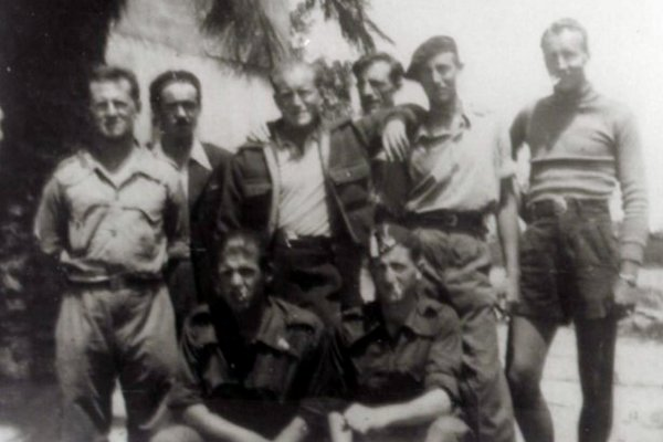 McCain's favorite Communist: Delmer Berg, standing second from right wearing a beret, with the Abraham Lincoln Brigade in Spain around 1938.